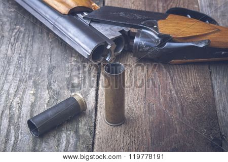 Hunting Rifle On A Wooden Background