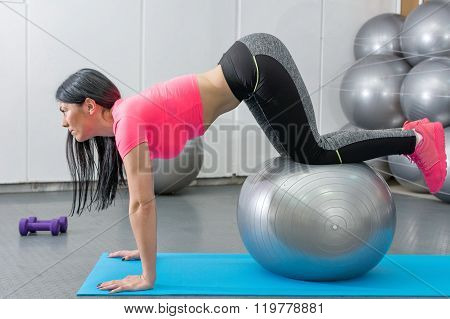 Girl Doing Reverse Ball Crunch
