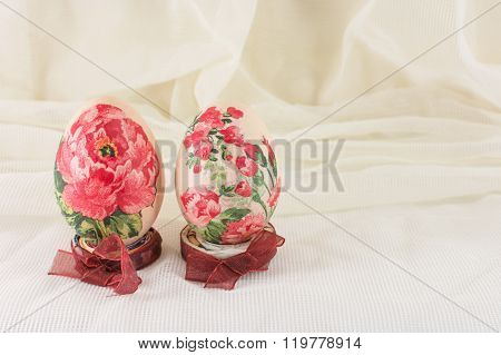 Decoupage Decorated Easter Eggs Against Silky Background
