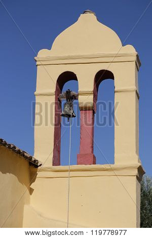 Yellow Bell Tower In Moraitika. Corfu. Greece.