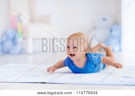 Baby Boy In White Nursery
