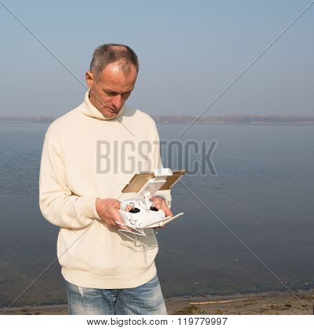 Man With Remore Controller Of Drone.