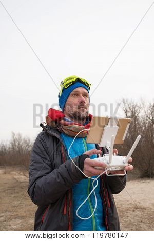 Bearded Man Carefully Controls The Flying Drone