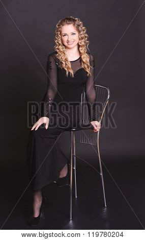 Elegant young woman over black