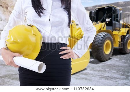 Female Engineer With Backhoe