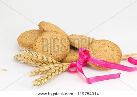 Integral Cookies And Wheat Plant On White Baclground