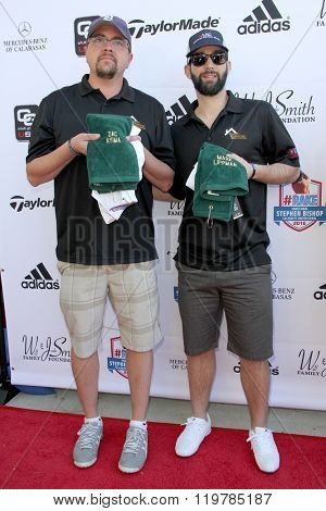 Zac Kylma and Mark Lippman arrives at the inaugural Stephen Bishop celebrity golf invitational benefiting R.A.K.E. on Feb. 15, 2016 at Calabasas Country Club in Calabasas, CA.