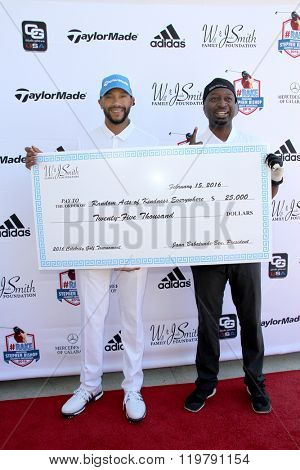 Stephen Bishop and Ricky Smith with donation (Will and Jada Smith Foundation) at the inaugural Stephen Bishop celebrity golf invitational on Feb. 15, 2016 at Calabasas Country Club in Calabasas, CA.