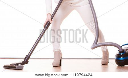 Girl With Vacuum Cleaner. Housework