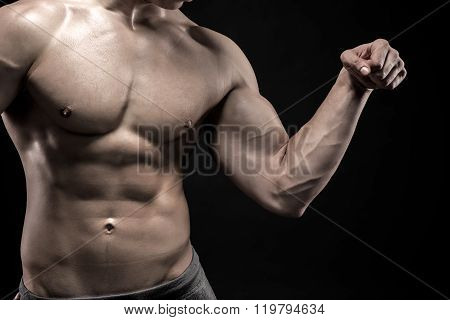 Close-up of man flexing showing his triceps, biceps muscles