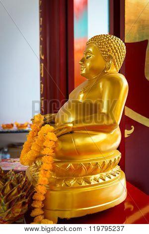Golden Buddha Statue On An Ornate Altar At Canton Shrine