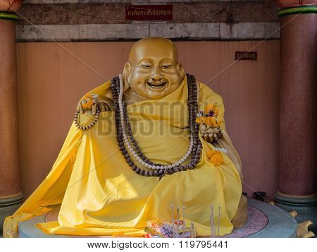 Golden Statue Of The Fat Laughing Buddha