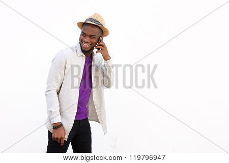 Stylish Young African Man Talking On Mobile Phone