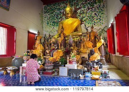 Buddhist Worshiper Praying In Buddhist Temple