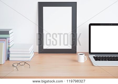 Blank Wooden Picture Frame On Wooden Table With Blank Laptop Screen, Book And Cup Of Coffee, Mock U