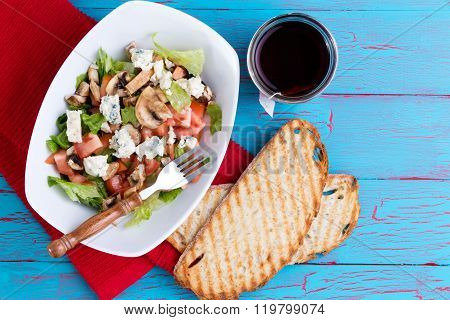 Healthy Salad With Tea On An Exotic Picnic Table