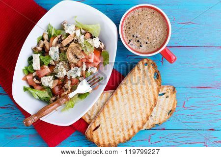 Fresh Mixed Feta Salad And Coffee On Picnic Table