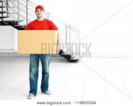 Man holding carton box in the room