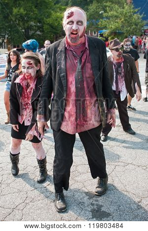 Group Of Bloody Zombies Stagger Along At Atlanta Pub Crawl