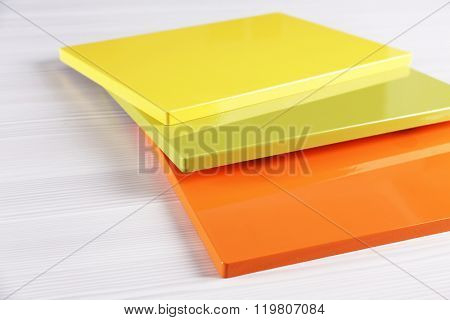 Samples of varicolored panels for furniture and door on light table