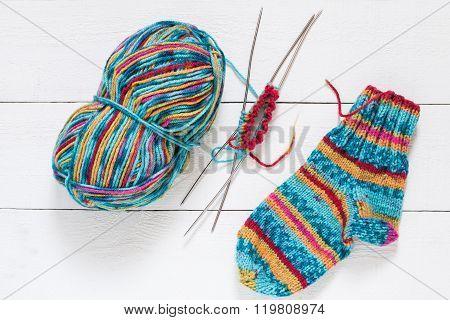 Variegated Yarn, Sock, Needles With Knitting