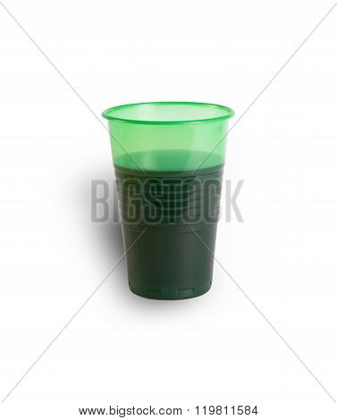 Green plastic cup with a drink