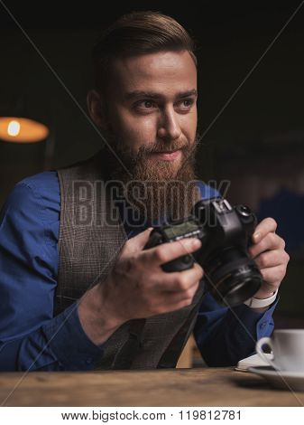 Handsome young male journalist is making shots
