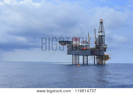 Offshore Jack Up Drilling Rig Over The Production Platform In The Middle Of The Sea On Black And Clo