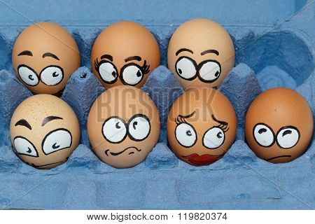 Nine Sad  Frightened Egg Faces In Blue Panel
