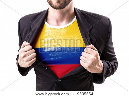 Businessman stretching suit with Colombian Flag isolated on white background