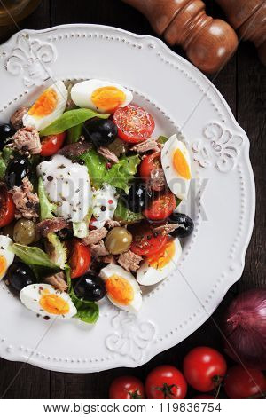 Salad Nicoise with eggs, tuna, anchovy, lettuce and olives