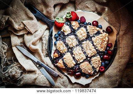 Homemade Berry Cake On Rustic Background