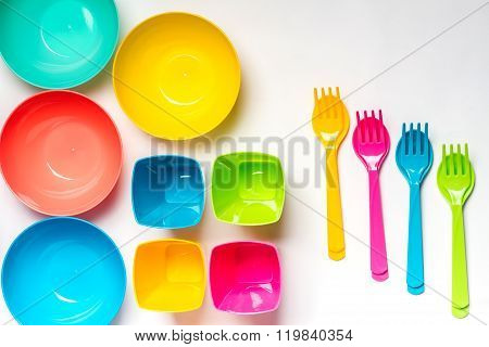 Bright Colorful Plastic Disposable Tableware On White Background