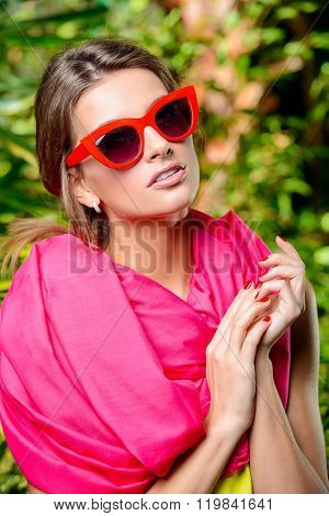 Summer young woman in bright yellow dress, crimson scarf and pin-up glasses. Beauty, fashion.