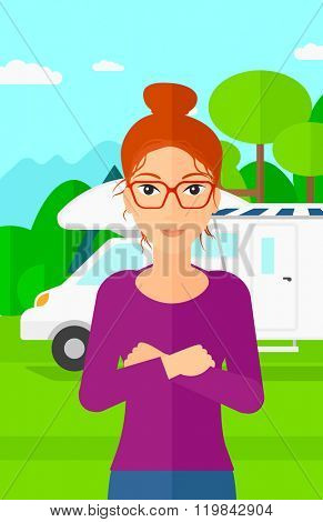 Woman standing in front of motor home.