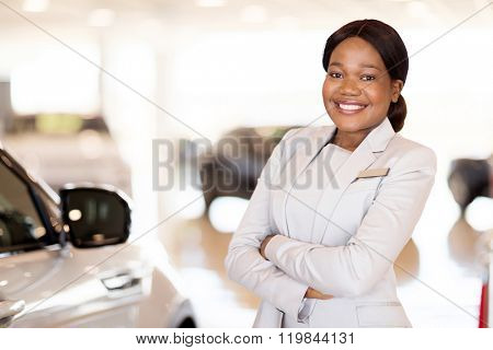 attractive young african vehicle saleswoman