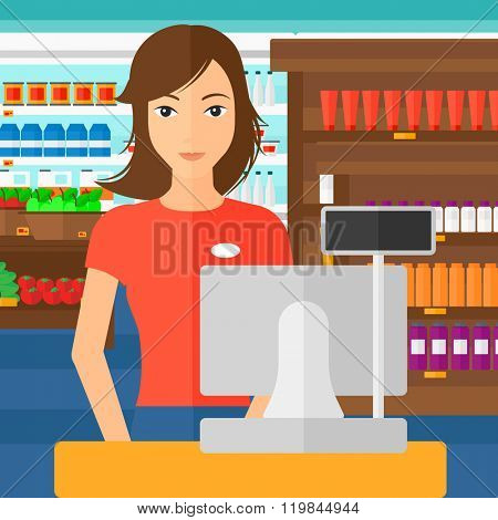 Saleslady standing at checkout.