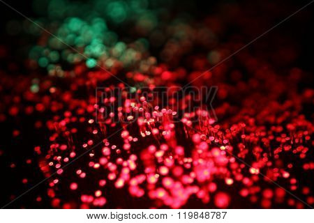 Detail of optical glass fibers transmitting data in red and green