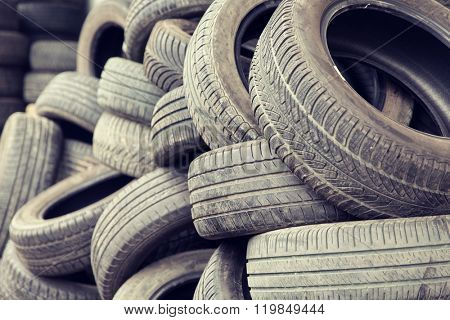 tire, maintenance, service and motor transport concept - close up of wheel tyres