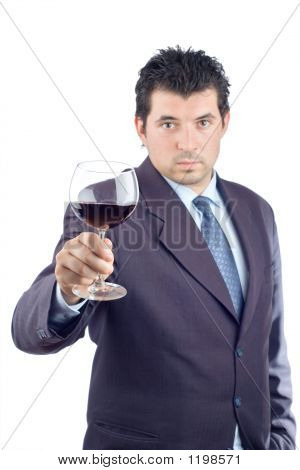 Man In A Suit Tasting Wine
