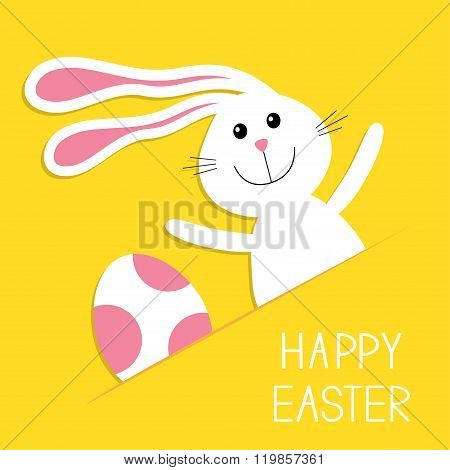 Happy Easter. Bunny Rabbit Hareand Pink Painted Egg In The Paper Pocket. Baby Greeting Card. Yellow