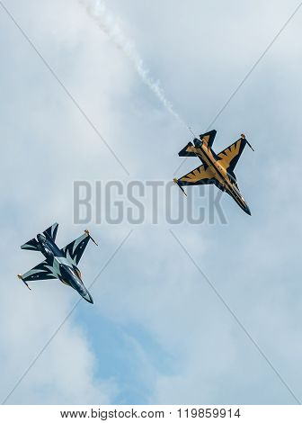 SINGAPORE, FEBRUARY 21, 2016: Aircraft from the Republic of Korea's Black Eagles aerobatic display team fly in 'V' formation during the 2016 Singapore Airshow. The airshow is the biggest of its kind in Asia.