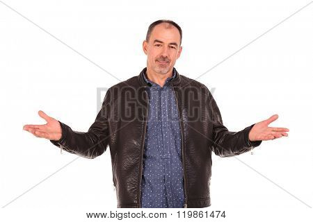 confident mature man in leather jacket welcoming with both hands in isolated studio background