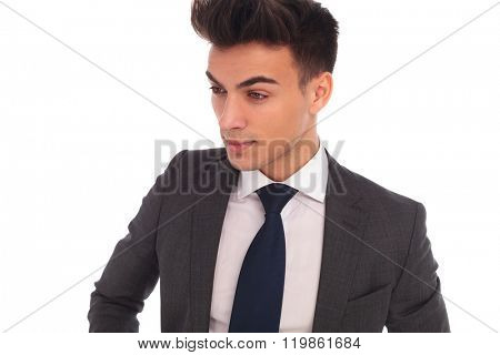 closeup side picture of a young elegant business man looking away from the camera on white background