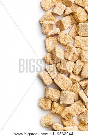 unrefined cane sugar cubes on white background
