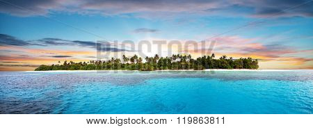 Beautiful nonsettled tropical island in sunset