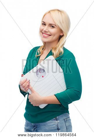 weight loss, diet, slimming, plus size and people concept - smiling young woman holding scales