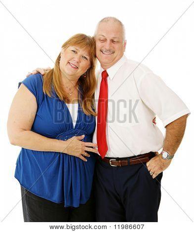 Loving mature couple together, isolated on white background