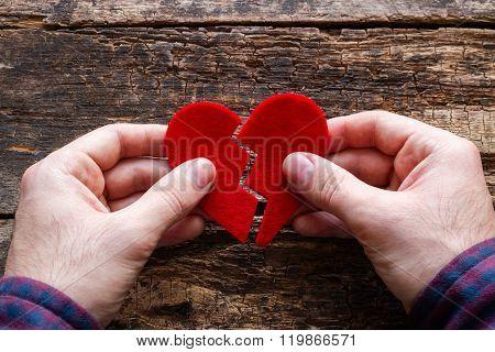 Man Holding A Broken Heart