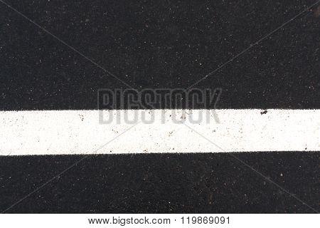 White Traffic Line On Asphalt Road.